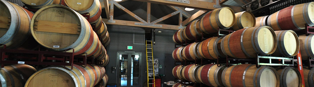 barrels of wine in a winery